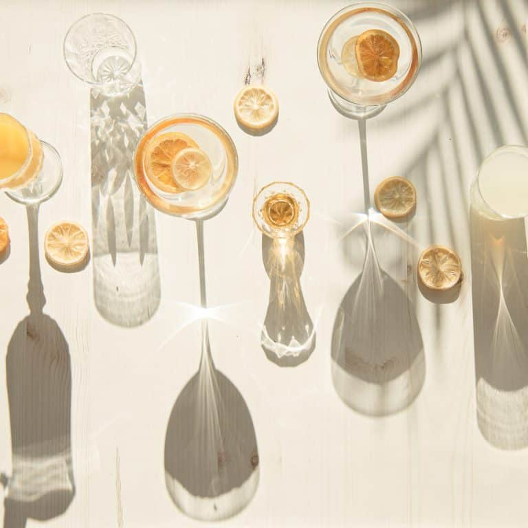 Flat lay of glasses and cups in harsh light